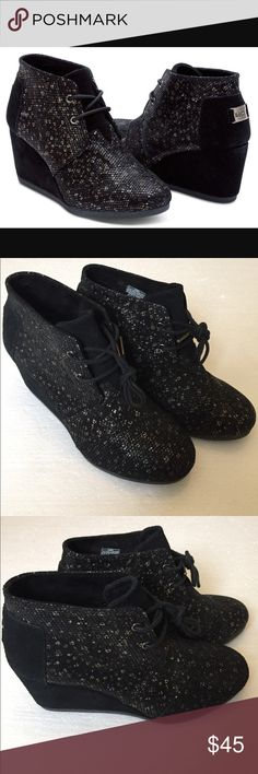 Toms Leather Printed Wedge Booties. Size 6.5. NEW Toms Leather Printed Black Desert Wedges. Size 6.5. NEW. Gold/silver detail. So cute! (Small amount of distressing on the back) Perfect with Spring dresses! TOMS Shoes Wedges