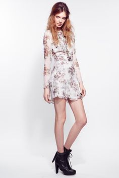 189.00 The For Love & Lemons Pure Dress in Ivory Floral comes from the brand's 'Interview with the Vampire' Fall 2013 collection. This piece is constructed from a soft chiffon with matching lining