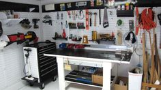 A Wall Control metal pegboard work area, great for bike and DIY activities.