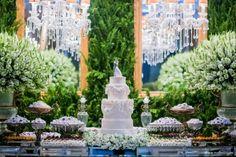 Glamorous wedding cake and dessert table.