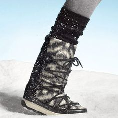 Stylish Snow Boots   Waterproof fabric keeps you dry, while the graphic print adds style. $575; Moncler.com