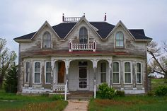 Old Worn & Weathered...grand house.  Wonder what this neat old house could tell you.