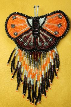 Osawamick's Wingush Crafts Kitigan - Orange, Red, and White Beaded Butterfly Hair Clip with Beaded Fringe, $50.00 (http://www.kitigan.com/orange-red-and-white-beaded-butterfly-hair-clip-with-beaded-fringe/)