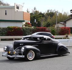 1939 Black Customized Plymouth Coupe with Radical Chopped Top, Skirts, Spinners, Visor, Teardrop Spotlights, White Walls & Headlamp Eyebrows. What's under the hood is a secret !!