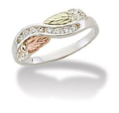 Black Hills Sterling Silver Woman Ring with Diamond (.16 tw) and Black Hills Gold 12k Leaves by Landstrom's Black Hills Gold Jewelry - See more at: http://blackdiamondgemstone.com/jewelry/rings/black-hills-sterling-silver-woman-ring-with-diamond-16-tw-and-black-hills-gold-12k-leaves-com/#!prettyPhoto