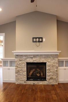 Built-in shelving around a fireplace doesn't have to be cumbersome! These small accent pieces add the storage you need but don't overpower the space. | C&M Home Builders, Eau Claire, Wis.