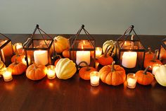 love the lanterns lined up similar to this for a head table for a fall wedding
