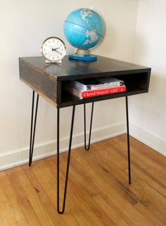 This new, mid century modern inspired box table with steel hairpin legs is handcrafted and would work well as a side table, end table or