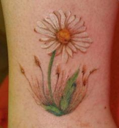 Daisy tattoo This is how I wanted my dandelion tat to look like more realistic and I got clip art...oh well! Still looks ok...I should of went with my gut... Micah