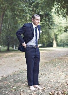 Slicked hair, cheeky smile, fantastic suit... and no shoes. Perfection, thy name is Martin Freeman.