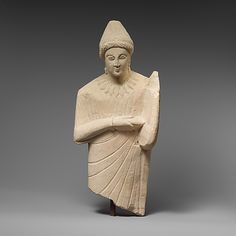 Limestone statue of a female lyre player c. 300 BC Cypriot (Source: The Metropolitan Museum)