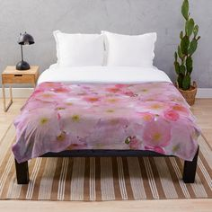 -  100% polyester fleece with soft, fluffy handfeel.   -  Printed on front with ivory colored back.   -  Edge-to-edge sublimation print.   -  Machine washable. . . #throwblanket  #blanket  #fluffyblanket  #softbanket  #warmblanket  #cherryblossom  #pinkflowers   #flowers  #japanesecherryblossoms #bitsofeverywhere