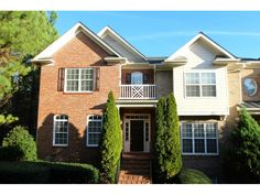 Spacious end unit townhome in upscale, gated community with swim and tennis.  Easy access to i85; convenient to shopping, restaurants, sugarloaf mills, gwinnett arena & more.  Sought after peachtree ridge schools.  New paint and carpet! Main level features hardwood floors, formal living, beautifu...