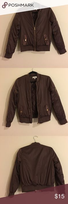Dark Brown Bomber Jacket Only worn once!! Thick and warm unlike some bombers, gold details on the zippers and pockets. Very neat and simple design, would pair easily with most outfits. Shoulders are cut very nicely as well. Size: XS (true to size, however if you don't mind a slightly tight fit you can make this work as a S) Charlotte Russe Jackets & Coats Puffers