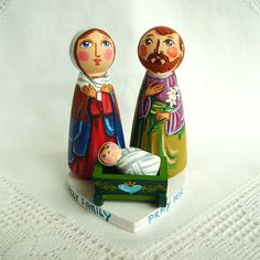 Holy Family Christmas Jesus Christ Saviour painted wooden nativity set baby Joseph Mother Mary peg doll figurine traditional colorful folk art child birthday birth christening baptism holiday communion gift present red souvenir keepsake heart snow manger figure holy night Blessed Virgin God decoration decor religious blue Madonna star winter wooden peg dolls wooden cradle heart non toxic acrylic paints non toxic water varnish lily green