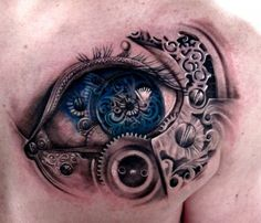 Amazing mechanical eye tattoo. Incredible!