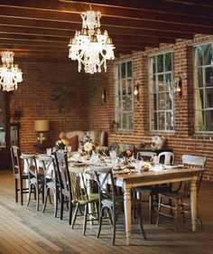 brick wall, eclectic chairs, perfect dining room