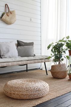 These little rattan ottomans are cheap at IKEA! They can be stacked up to make a little end table or higher seat or you can scatter them for floor seating. The basket with the plant is also from IKEA (Fljadis Basket (spelling? Ikea Outdoor, Outdoor Living, Rattan Ottoman, Bali Furniture, Home Interior, Interior Design, Floor Seating, Style Deco, Houses