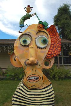 I love the guy who is pushing the mower and how his head is a coffee pot upside down. The person getting the hair cut reminds me of Carrot Top - the comedian. Created by Patrick Amiot and Brigitte Laurent Sculpture Art, Sculptures, Junk Art, Sonoma County, Garden Furniture, Comedians, Whimsical, Recycling, Artsy