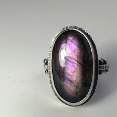 Purple labradorite cabochon hand fabricated by Sara Westermark. Custom order with medieval style band.