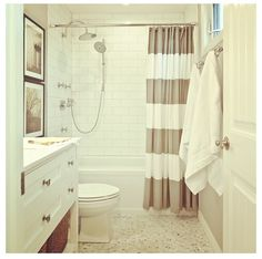 2 things: the extra tall vanity cabinet & the arching waterfall shower head. #westelm