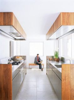 30 Cool Industrial Design Kitchens.  I like the way the fans and lights are hidden in the bulkheads
