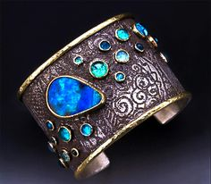 Lauarie MacAdam - Boulder Opal, Aquamarine, Apatite and Blue Topaz  Sterling Silver and 14 Karat gold