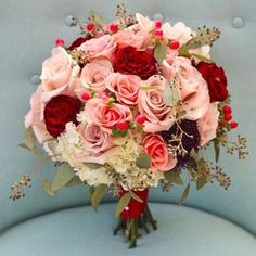 """I am loving this bridal bouquet! Deep red roses accenting blush and dusty pink roses! This is a classic but beauty! #roses #bouquet #flowers…"""