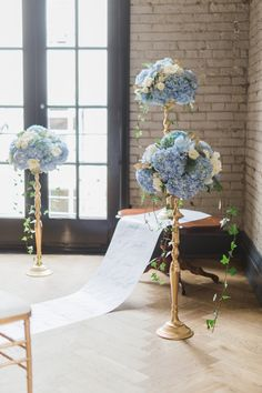 blue and gold floral wedding ceremony