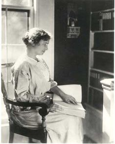 Helen Keller Pictures of reading in brail | Helen Keller seated in a library in front of a window, reading a ...