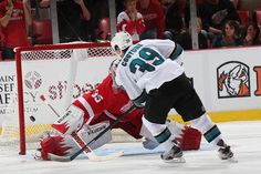San Jose Sharks forward Logan Couture scores the lone goal of the shootout and of the game (Oct. 21, 2013).