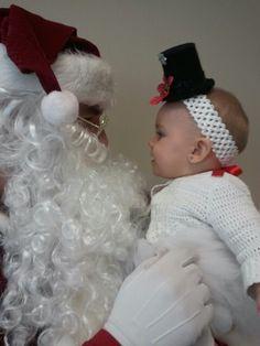 Chloe in her snowman tutu meeting Santa!