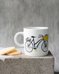 Bicicletta Short Mug - This classic-shaped mug is a surefire conversation starter. A whimsical bicycle cruises along a cobblestone street, carrying a basket of fresh market flowers. Textile Company, Fresh Market, Teacher Gifts, Mother Day Gifts, Surefire, Original Artwork, Whimsical, Cruises, House Design