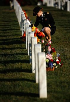 """""""2nd Lieutenant Jenna Grassbaugh, whose husband Captain Jonathan Grassbaugh was killed in Iraq, remembers lost colleagues while visiting Arlington National Cemetery November 11, 2007 in Arlington, Virginia. Family and friends of U.S. service members across the country remembered the nation's military personnel today on Veterans Day."""" (Photo by Win McNamee/Getty Images)"""
