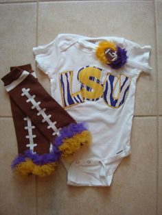 LSU Onesie, football leg warmers, headband....TJ sure would love this, but I would prefer the Hogs :) it would be a lot cuter!