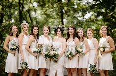 Bridesmaids in short ivory dresses
