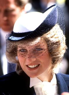 A pregnant Princess Diana (1961 - 1997) during a visit to Warrington with Prince Charles, May 1984. She is wearing a navy coat by Jan van Velden and a hat by Frederick Fox.