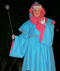 fairy godmother @Tara Smith something like this....I think this is at Disney but a simple blue cape with a pink bow would work.