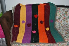 http://www.ravelry.com/patterns/library/tulip-baby-blanket