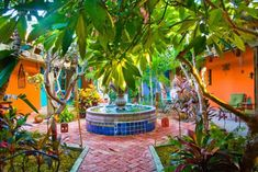 Mexican Garden With Brick Walkway And Large Fountain : Amazing Mexican Garden Style