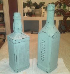 Repurposing liquor bottles with chalk paint...