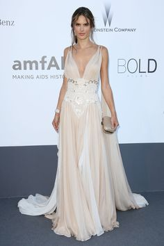 Alessandra Ambrosio wore a Zuhair Murad nude chiffon full-length gown with plunging neckline and beaded detailing and carried a Jimmy Choo clutch.