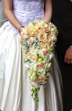 Incredible cascading bridal bouquet of blush and white flowers designed by affair with george #weddings #cascading #bouquet