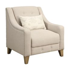 Add a touch of sophistication to your home decor with this simple Georgina accent chair. Finished in a gently tufted beige polyester fabric, this plush chair comes with a small decorative French kidney pillow to add elegant Parisian style.