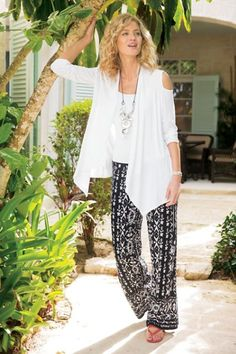 "The fluid drape of a skirt, the free movement of pants – these striking pull-ons blend the best of both in a wide-leg silhouette with global flair. Light crinkled gauze with a comfortable smocked waistband; sits at the natural waist. Rayon. Misses 30"" inseam. Azteca Pants #2AJ19"