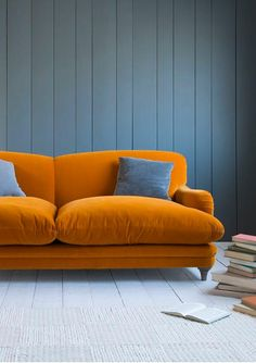 SeasonsinColour | The best 20 Velvet Sofa looks {October 2015} BURNT ORANGE + GREY This beautiful plush velvet sofa from Loaf is on the money. As comfortable as it looks, this sofa is one that most households would be able to easily add. If your walls are in a lighter colour (or even better white) imagine how well this sofa would go with an IKEA Stockhold rug. Yes, that black and white stripey one.