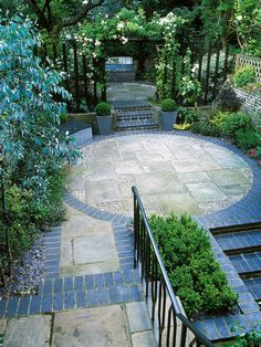 Circle Driveway With Boxwood Hedge Around Water Fountain