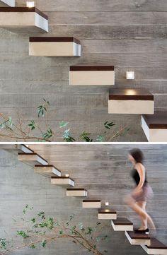 escalier intérieur de design original et moderne à marches flottantes en béton et bois