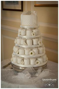 Graduated dot piping...could do champagne colored fondant with ivory piping