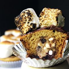 S'mores Cookie Dough Cupcakes: S'mores Cookie Dough, Graham Cracker Cake, Chocolate Ganache, and Toasted Marshmallow. Summer in a cupcake!